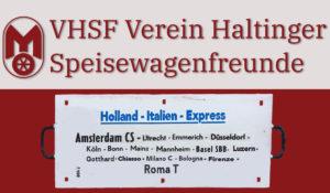 Mitropa-Signet und Schriftzug VHSF Verein Haltinger Speisewagenfreunde, darunter in einem roten Rechteck die weisse Routentafel des Holland-Italien-Express